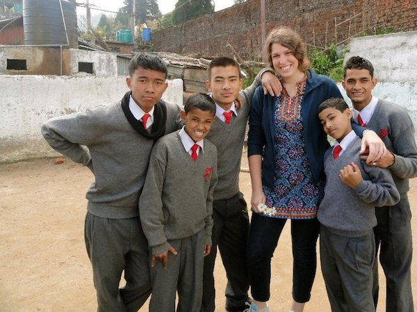 Bethany Flanders with students in Asia