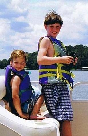 Jon and Sam on a boat