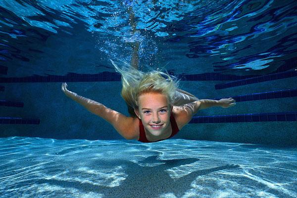 Young Girl Swimming Underwater