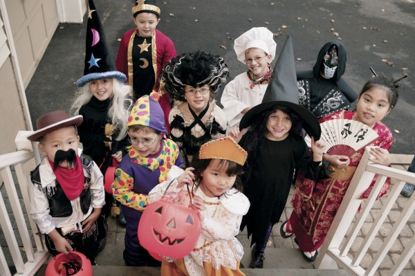 Children Trick-or-treating --- Image by © Royalty-Free/Corbis