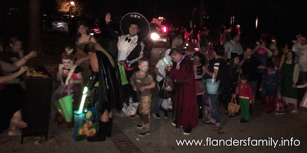 Passing out candy and tracts to trick-or-treaters