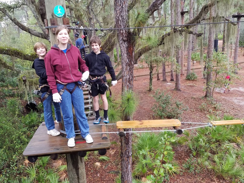 Rachel leads the way on the ropes course at TreeUmph!