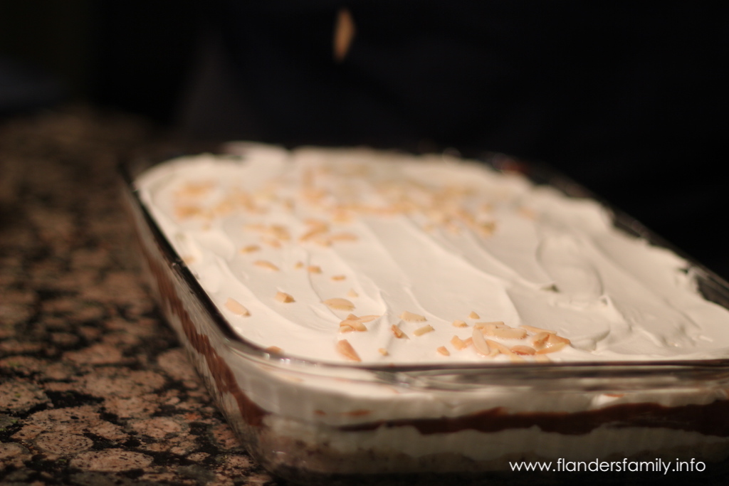 Top chocolate delight with toasted almond slivers