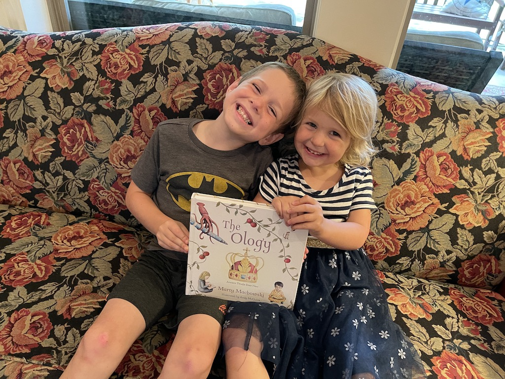 Noah and Lydia with family devotional book